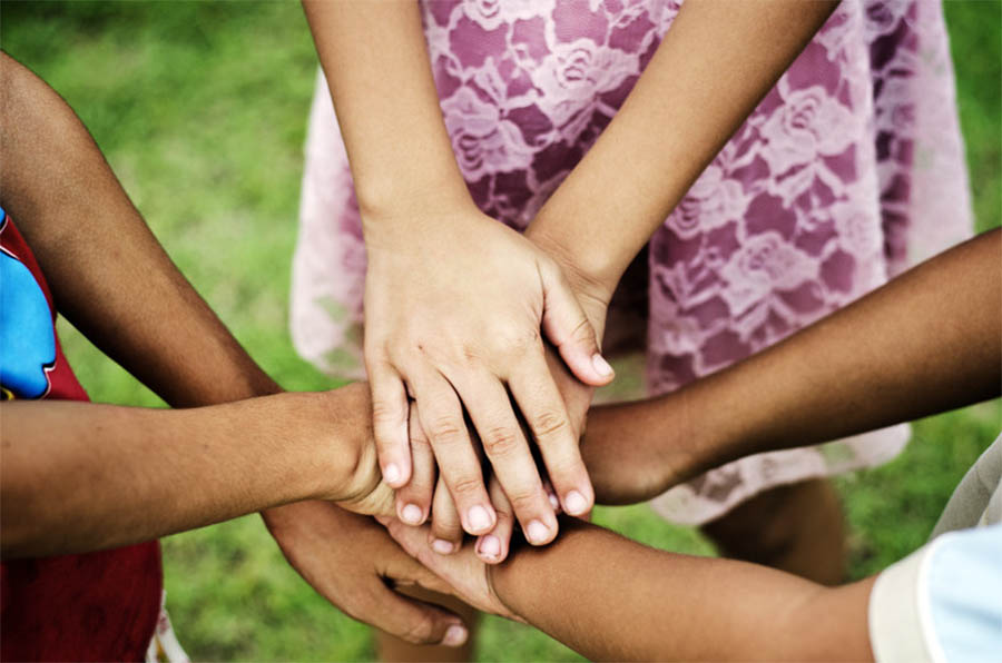 group of clasped hands