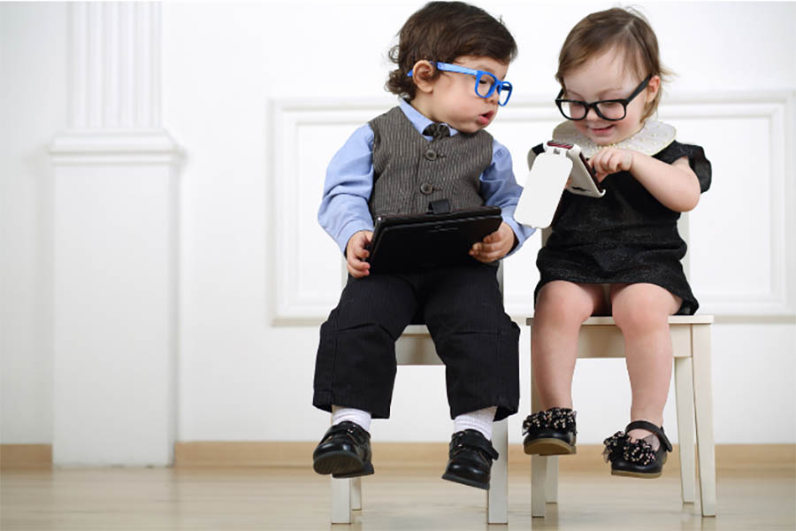 two toddlers in business clothes